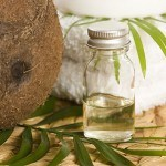Picture of coconut oil with coconut and towel