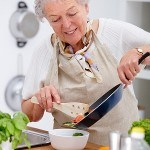 Seniors cooking with coconut oil photo