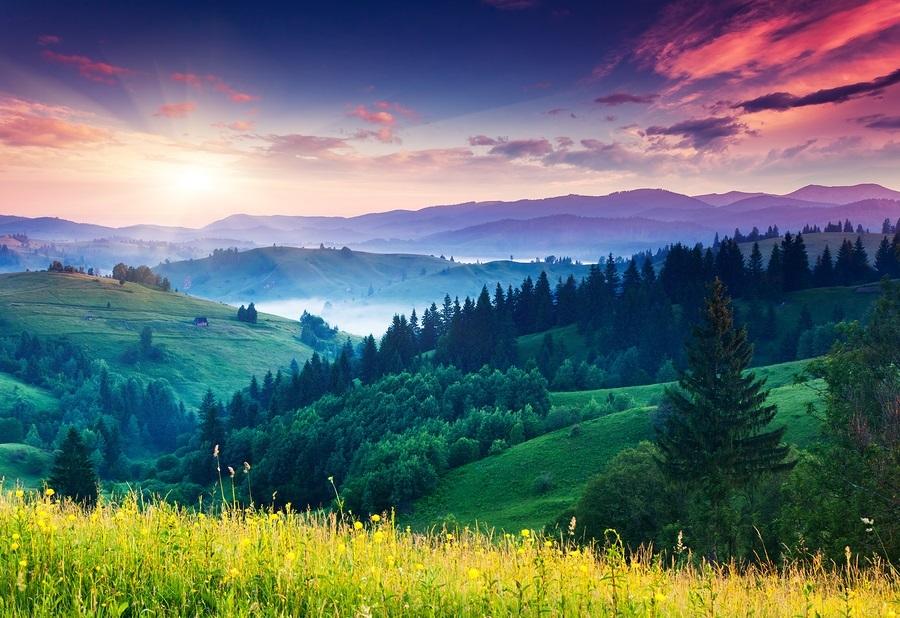 Fantastic morning mountain landscape. Overcast colorful sky. Car