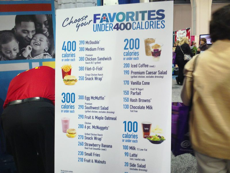 """Another advertisement/marketing tool at the McDonald's booth at the last Academy of Nutrition and Dietetics' expo.    As is par for the course for Big Food, they focus on calorie contents to distract from worrisome ingredients and poor nutrition. A """"McDouble"""" and chicken nuggets make the list of foods that McDonald's considers fitting to stress to Registered Dietitians as healthier choices. Most disturbingly, AND doesn't seem to think there is anything problematic with this sort of messaging at their conference."""