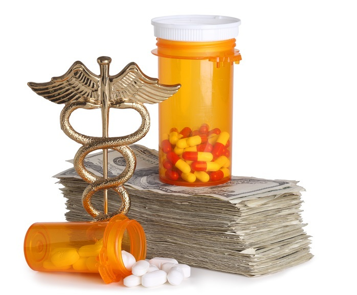 Costly healthcare concept, caduceus, money and pills cut out on