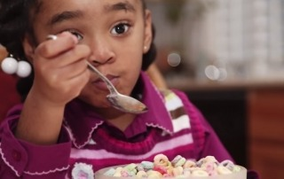 GMOs-girl-eating-breakfast-cereal