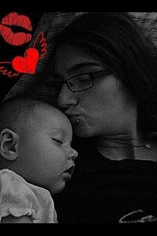 Bowling mom kissing baby