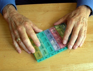 Elderly_Hands_Holding_Pill