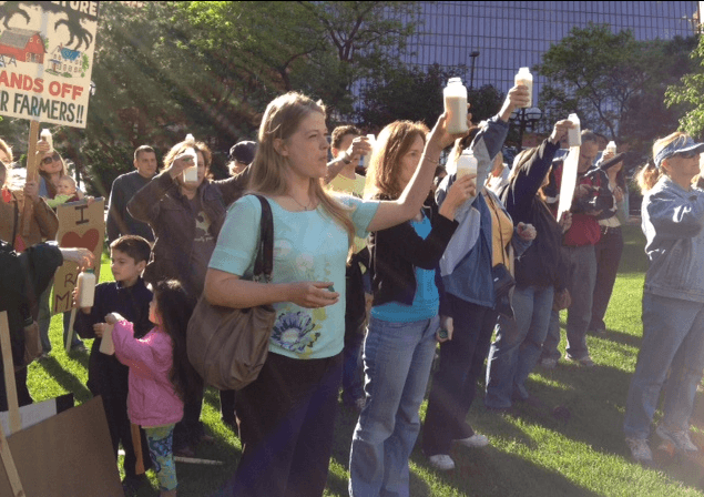 Food rights demonstrators for Alvin Schlangen raise bottles of raw milk in a toast photo