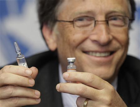 Gates co-chair of the Bill & Melinda Gates Foundation poses with vaccine against meningitis during a news conference at the United Nations in Geneva