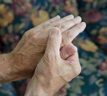 man massaging hands