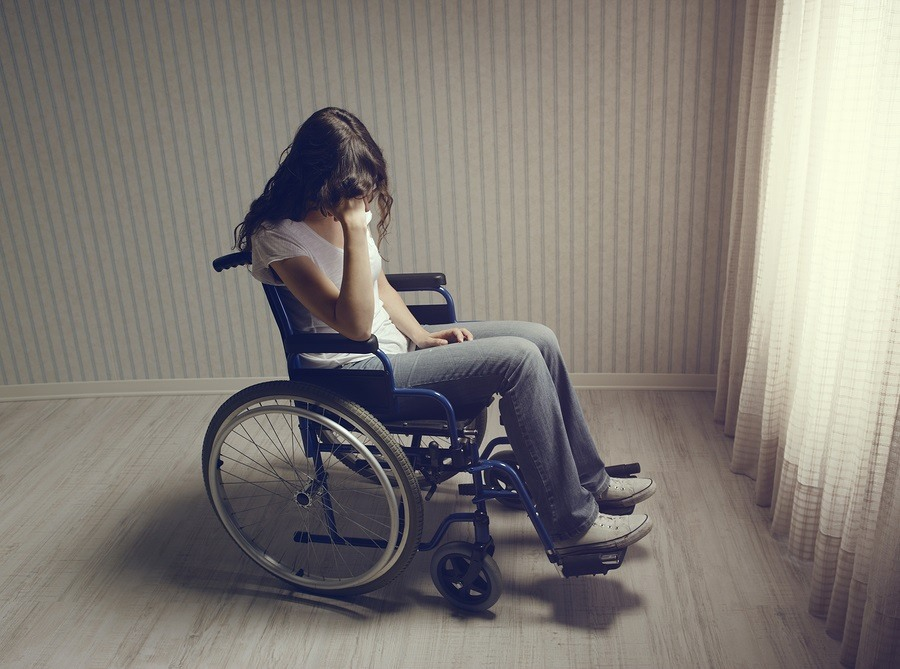 Crying-Woman-Sitting-In-Wheelchair