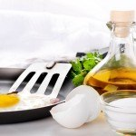 Fried eggs on a frying pan with olive oil
