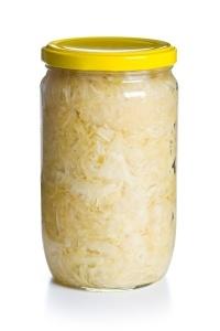 sauerkraut in jar on white background