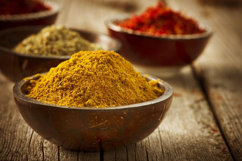 bowl of turmeric powder and other spices