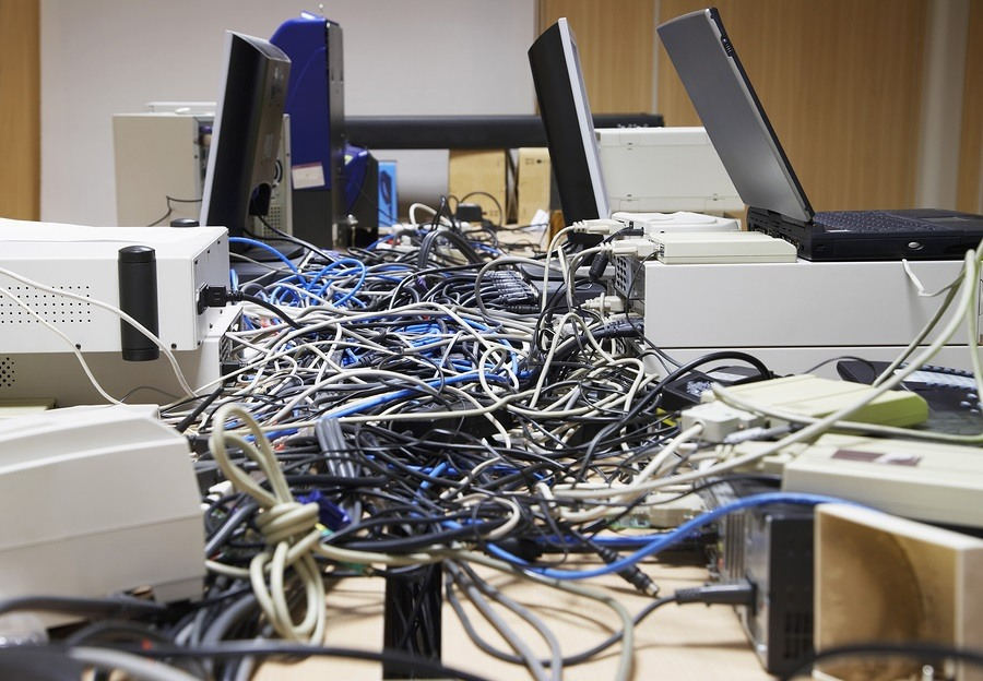 Closeup side view of messed wires connecting computers and print