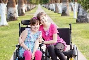 Diegel-sisters-in-wheelchairs2-300x202