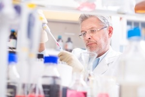 Life scientist researching in laboratory. Life sciences study living organisms on the level of microorganisms, viruses, human, animal and plant cells, genes, DNA...