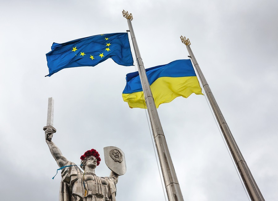 "KIEV UKRAINE - May. 08 2015: Flags of the European Union and Ukraine against monumental statue of the ""Mother Motherland"" devoted the Great Patriotic War"