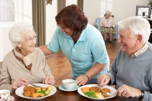 Senior-Couple-Being-Served-Meal-300x200
