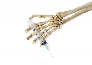 Skeleton-Hand-With-a-Hypodermic-needle-300x212