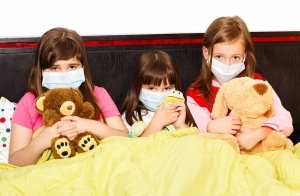 infected-children-wearing-masks-300x196