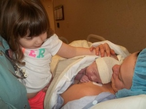 Holly-with-new-baby-and-big-sister1-300x225