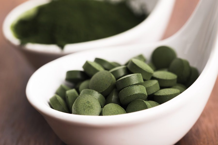 Green chlorella. detox superfood. close - up