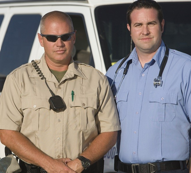 Portrait of a traffic cop and EMT doctor standing together