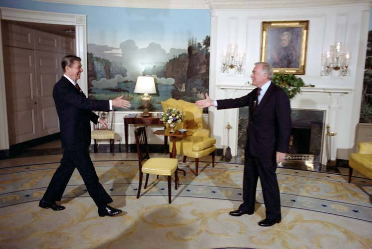 3/3/1981 President Reagan greeting Walter Cronkite for an interview in the Diplomatic Reception room