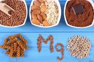 Inscription Mg ingredients and products containing magnesium and dietary fiber healthy nutrition wholemeal pasta sunflower buckwheat oatmeal linseed almonds chocolate powdery cocoa