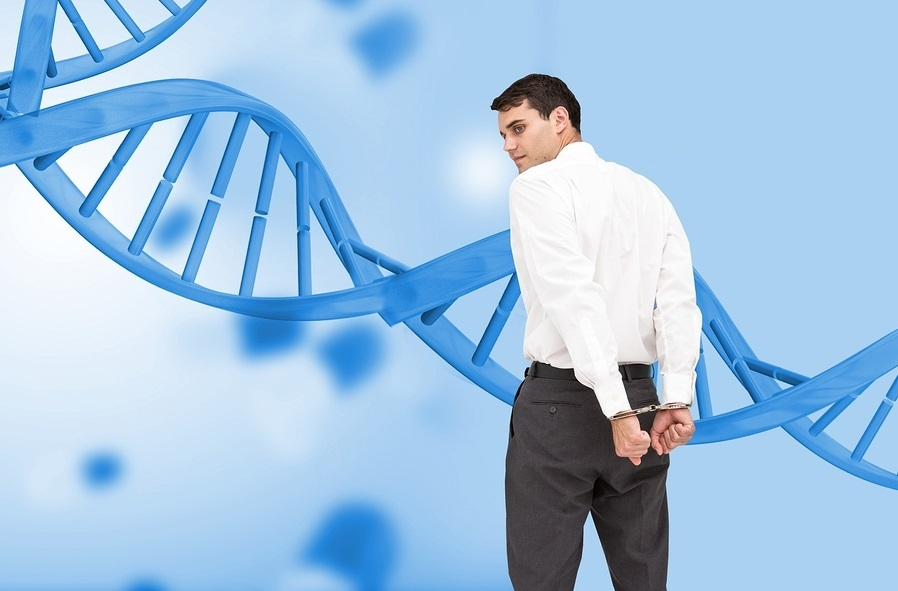 Composite image of businessman wearing handcuffs in front of dna spiral