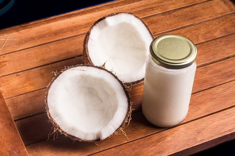 Coconut Oil Jar over a wooden table