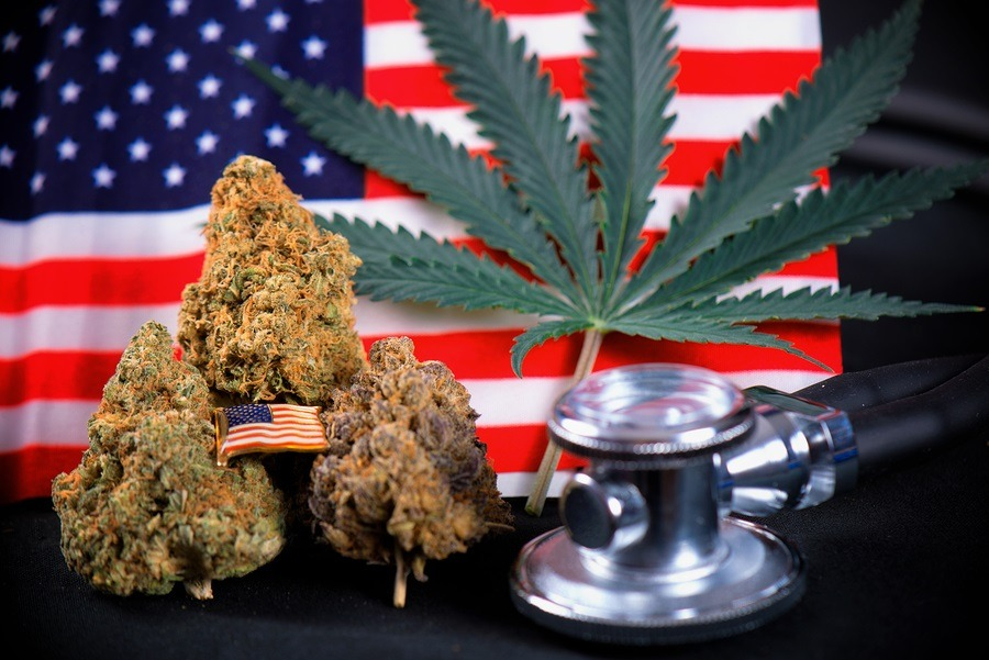 Cannabis bud, leaf and american flag - veteran theme medical marijuana concept