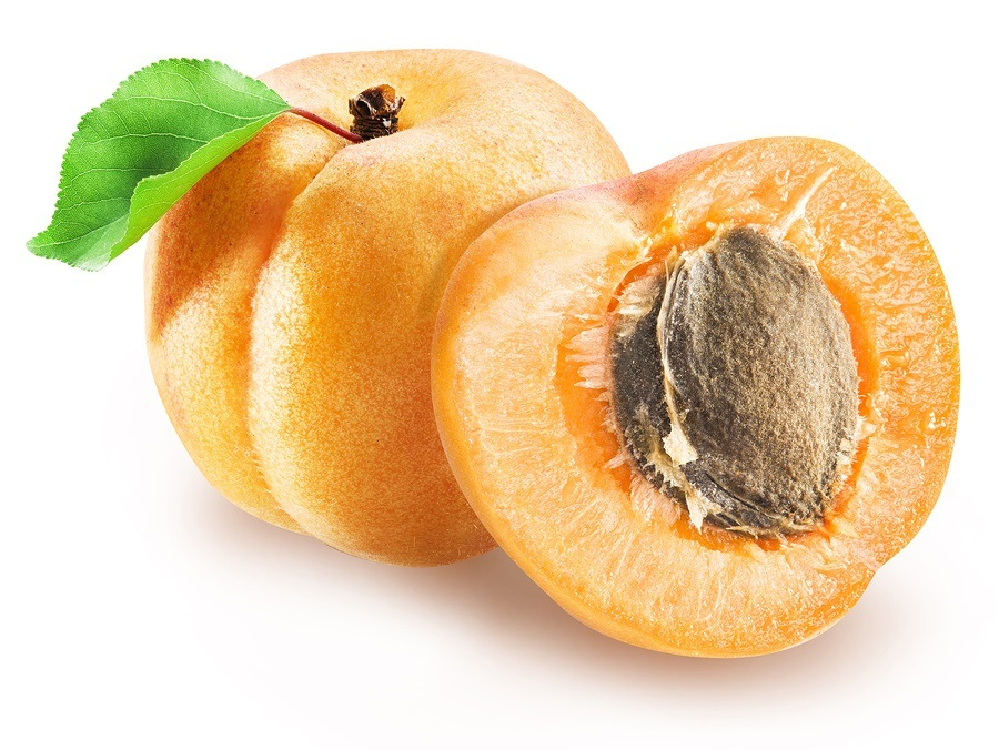 Ripe apricot and apricot cross section.