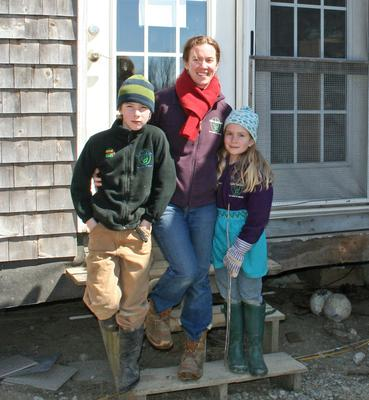 Heather Retberg at her Penobscot farmhouse on Quill's End Farm with daughter Carolyn and son Ben.