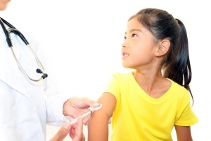 Doctor-injecting-child-vaccine-300x200