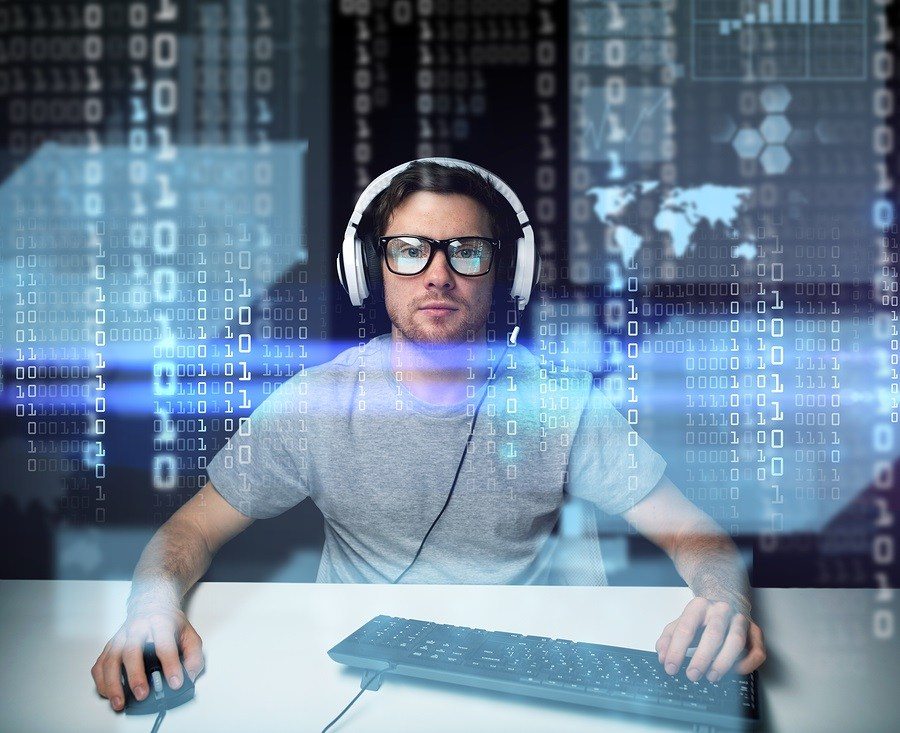 hacker in headset and eyeglasses with keyboard hacking computer system
