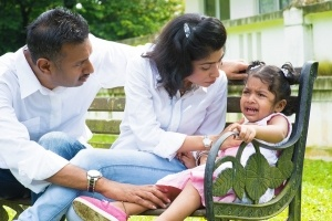 Indian-family-outdoor-Parents-child-crying-300x200