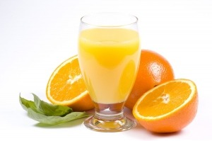 a picture of some juicy oranges and a glass of orange juice