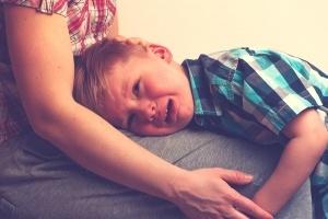 child-crying-moms-lap-300x200