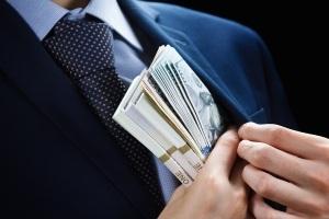 Concept for corruption finance profit bail crime bribing fraud auction bidding Bundle of dollar cash in hand