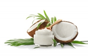 Composition with coconut oil in jar on white background