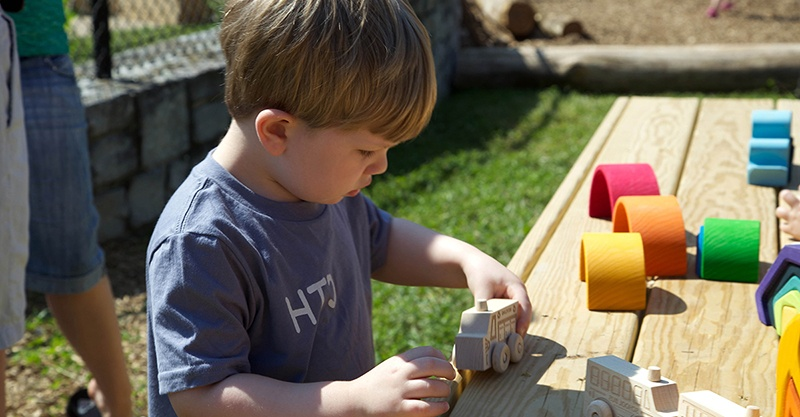 child boy playing Nature Explore Outdoor Classroom