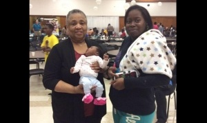 Milwaukee-Healthy-Beginnings-Milwaukee-African-American-Infant-Mortality-Task-Force-Patricia-McManus-holding-baby-FB-300x179