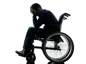 handicapped-man-head-in-hands-wheelchair-300x224