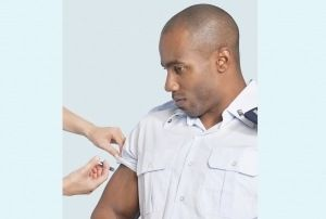 Young-military-man-getting-vaccine-FB-300x202