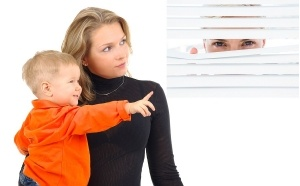Mother-playing-with-her-son-someone-watching-300x186