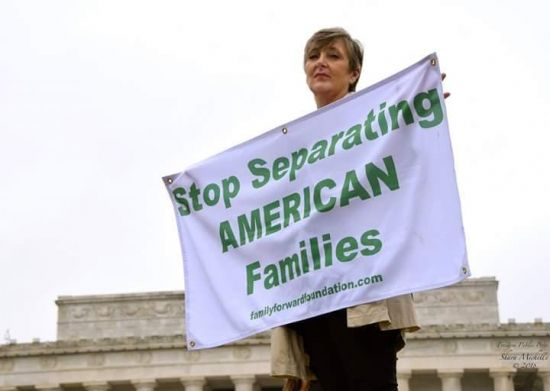 Connie-with-Separating-American-Families-sign-e1537100517853