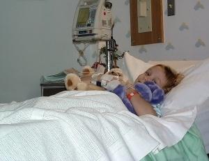 Girl-In-Hospital-Bed-300x231