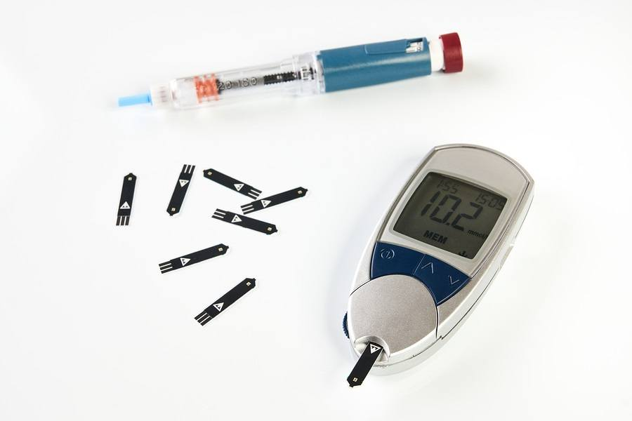 Diabetes equipment Insulin pen and glucose level blood test isolated on white background with copy space. Diabetic items to control diabetes blood sugar meter insulin pen glucose injection.