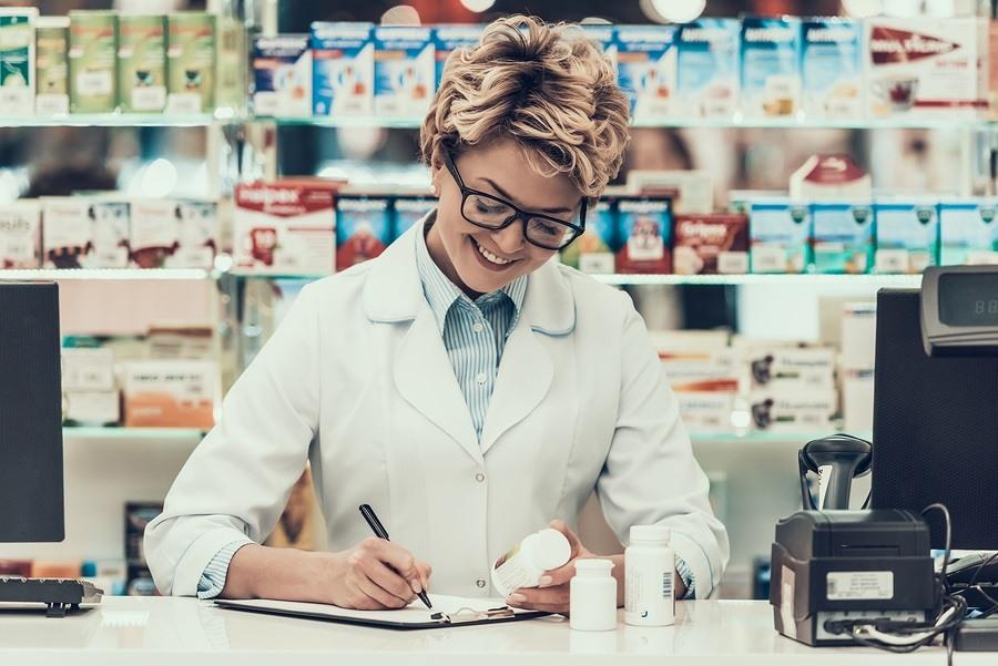 Portrait Smiling Pharmacist Working in Drugstore.