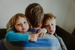 Sad-Kids-Hugging-Father-300x200