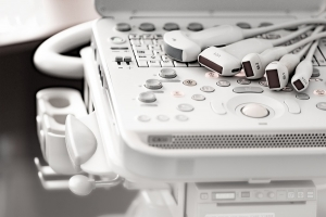 Various ultrasound sensors lie on the keyboard of the ultrasound machine